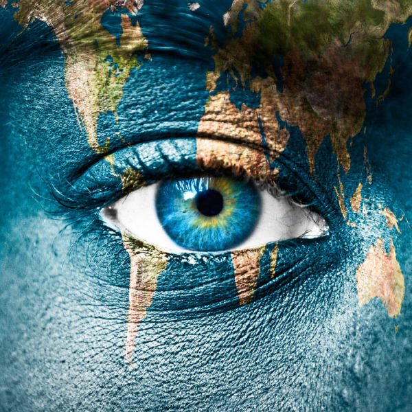 Image of a map of the world superimposed on a human eye to illustrate how to implement quality market research