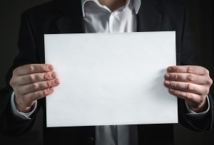 business man showing blank piece of paper