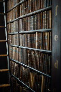legal book rack - Photo by Malte Baumann on Unsplash to illustrate making redundancy positive